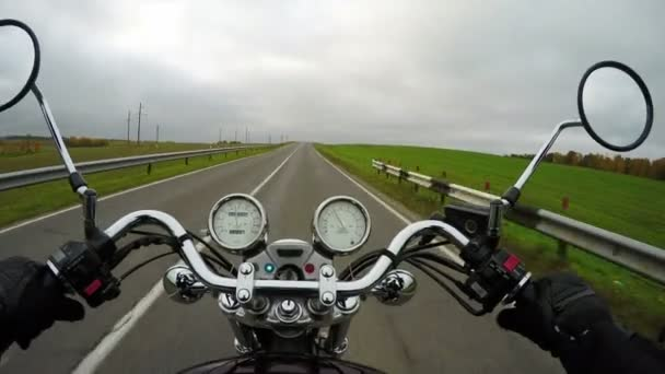 4K. Motorcycle rides on the beautiful road at cloudy day, wide point of view of rider. Classic cruiser/chopper forever!