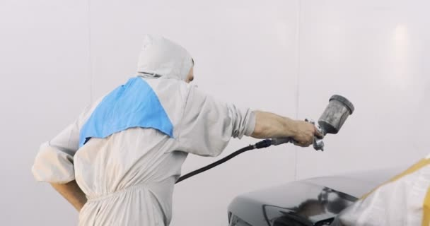 car painting with professional spray gun