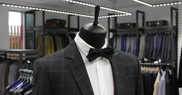48c85762234 Stylish mens suit. Mens jacket on a mannequin. Mens Clothing. Clothing store.  Shopping in boutiques.– stock footage