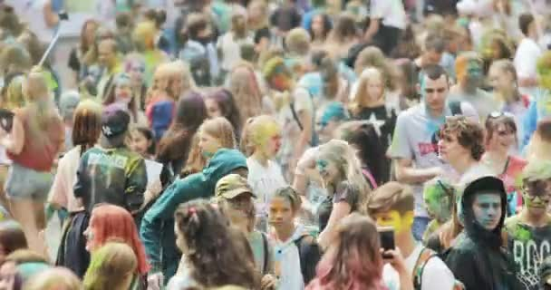 NOVOSIBIRSK RUSSIA - 21.07.2018: dancing crowd on Holi Festival Of Colors. Crowd of people colored powder and having fun.