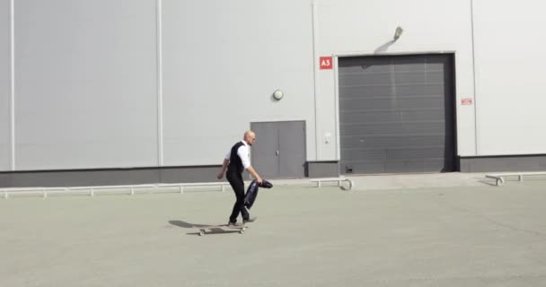 Businessman long boarding to job. Cool guy skates on his long wooden longboard