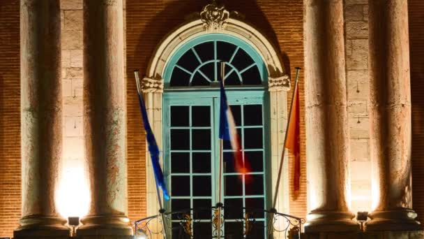 Flags on Capitole, is heart of municipal administration of French city of Toulouse and its city hall. It is supposedly on spot that St Saturninus was martyred.