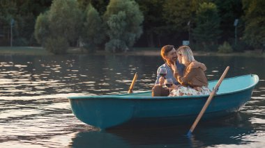 Attractive couple in a boat on a romantic date