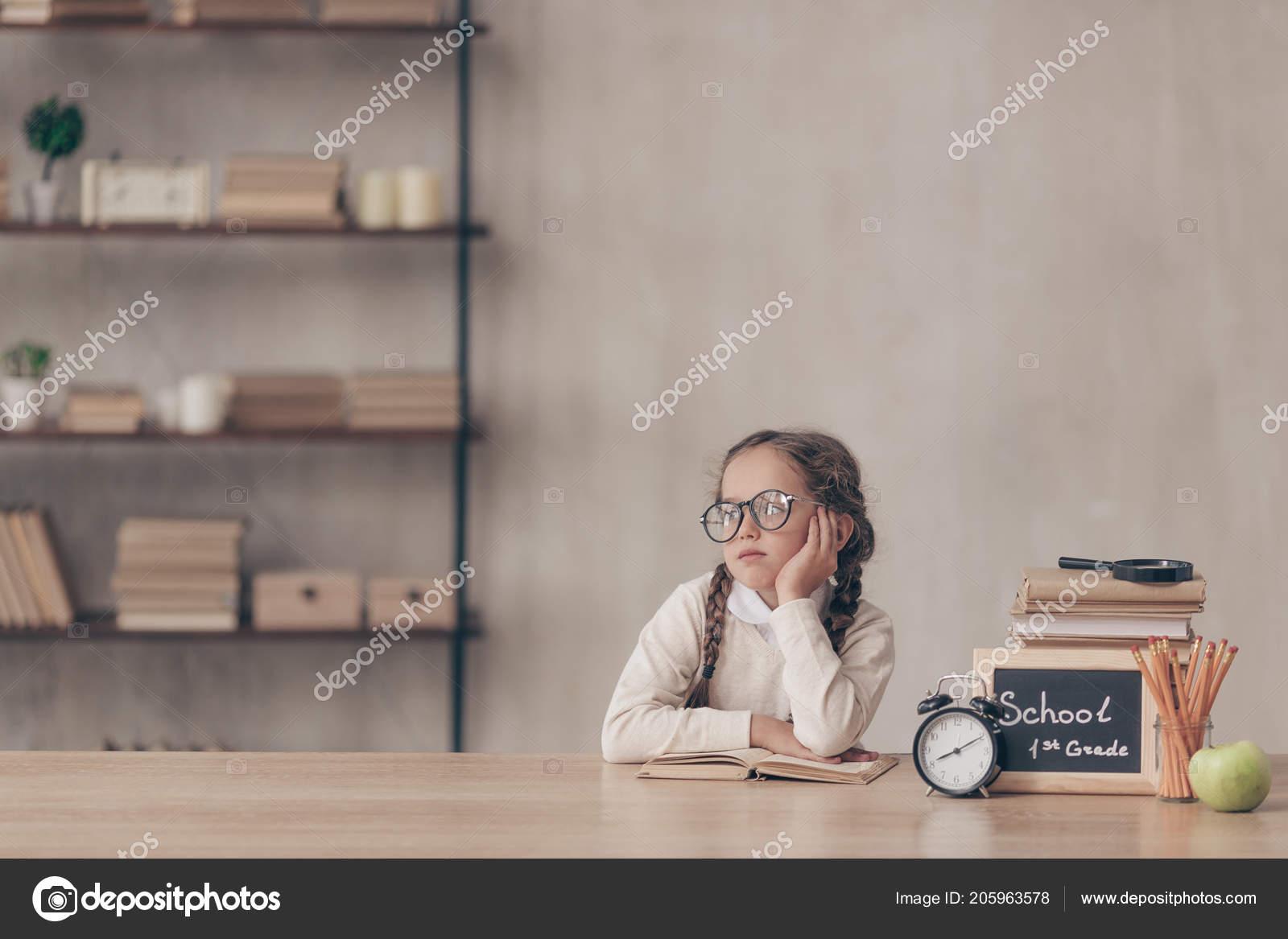 Bored Little Girl At The Desk In Studio Photo By Deklofenak