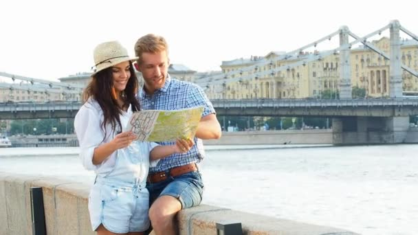 Smiling couple with map