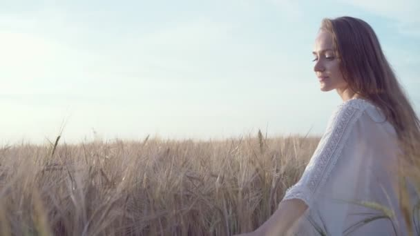 Attractive girl in a field in slow motion