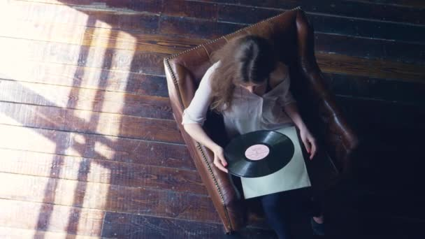 Young girl with a phonograph record