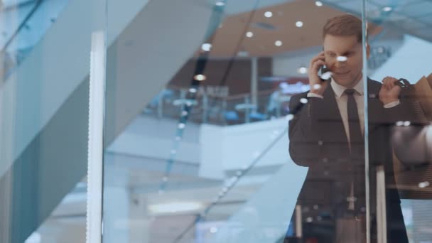 Young man talking on the phone in the mall