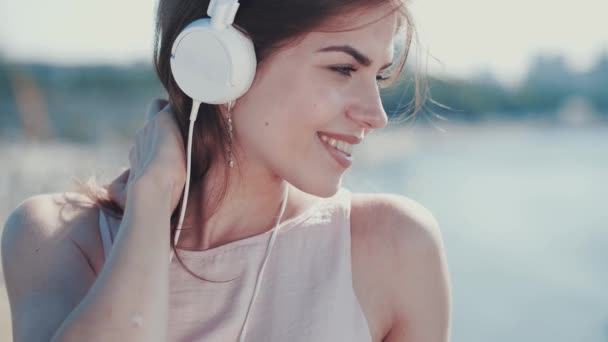 Attractive woman with headphones outdoors