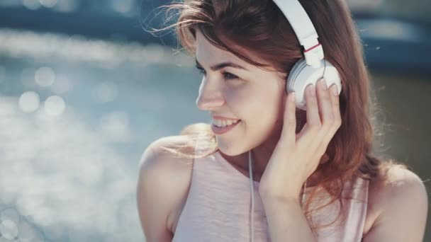 Beautiful young girl listening to music