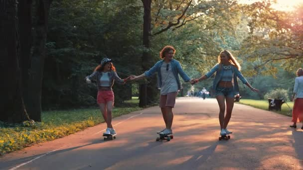 Happy young people skateboarding