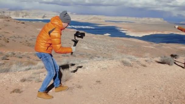 Photographer shooting video in the desert in Arizona