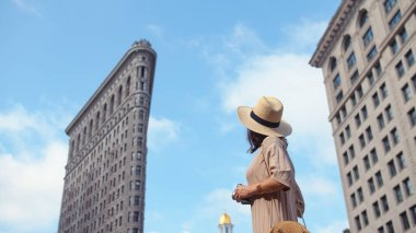 Young girl at the Flatiron building in New York City