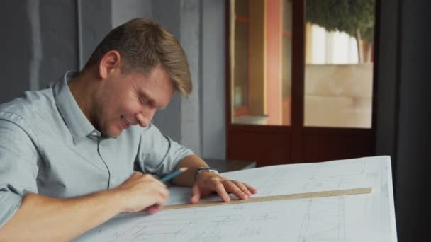 Smiling young architect at work in office