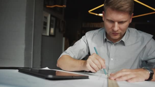 Working young professional with tablet in office