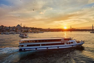 Bosphorus strait with ferry boats on the sunset in Istanbul, Turkey