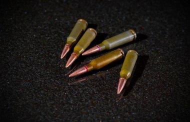 Ammunition cartridges on black background stock vector
