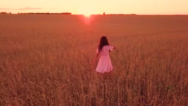 Young girl walking on wheat field