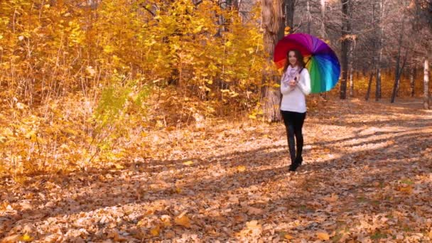Young girl walking in autumn forest