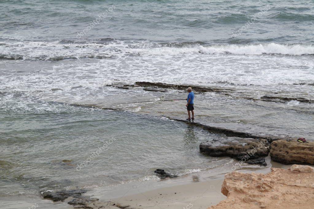 Torrevieja, Spain - Oct 05 2018 :   Beach fishing from the shore near Horadada
