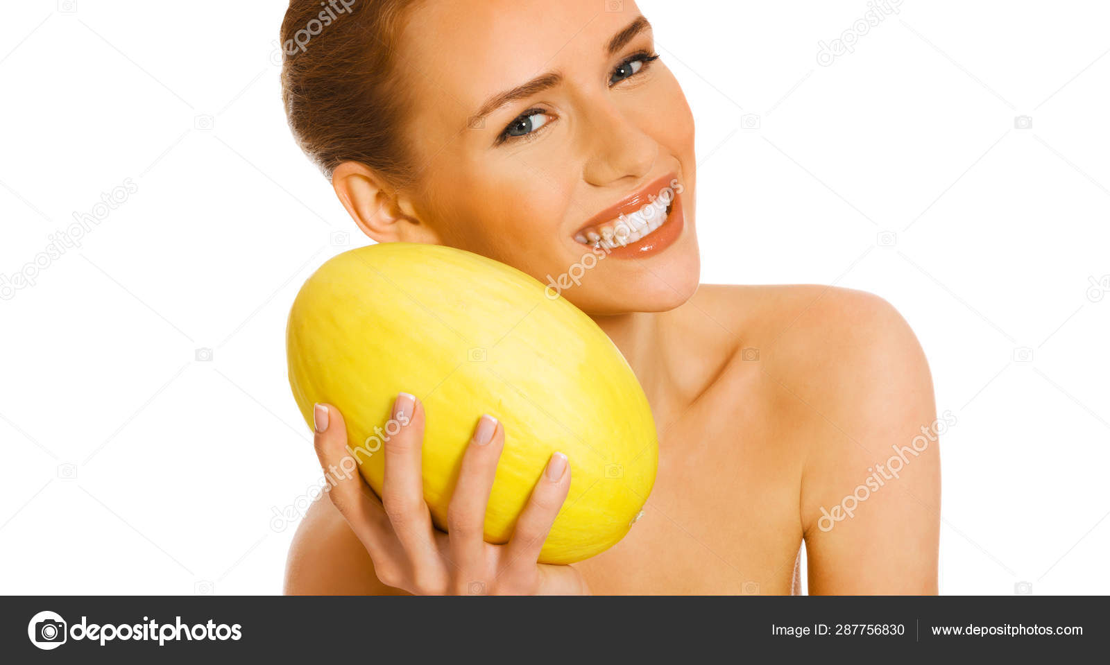 Horny bitch gives pose with holding a water melon piece