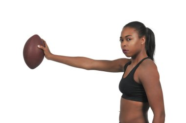 beautiful young woman quarterback while throwing a football