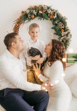 Family at home with decorated Christmas interior