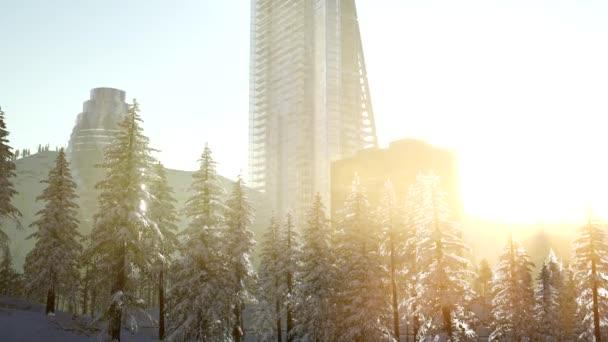 město a Les ve sněhu při východu slunce