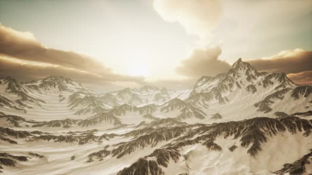 Panorama of High Snow Mountains at Sunset