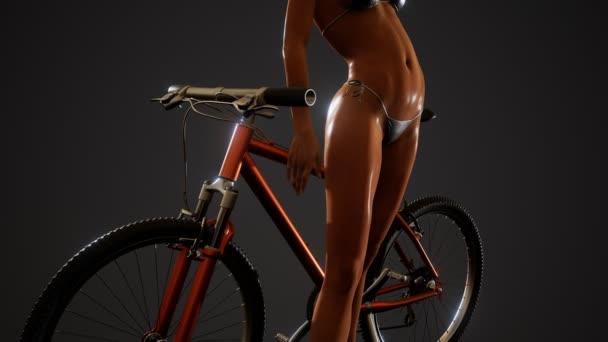 Sexy žena v plavkách s bicykl