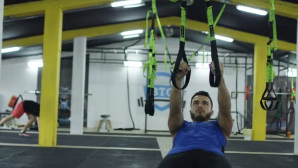 young athlete man working out at the cross fitness gym
