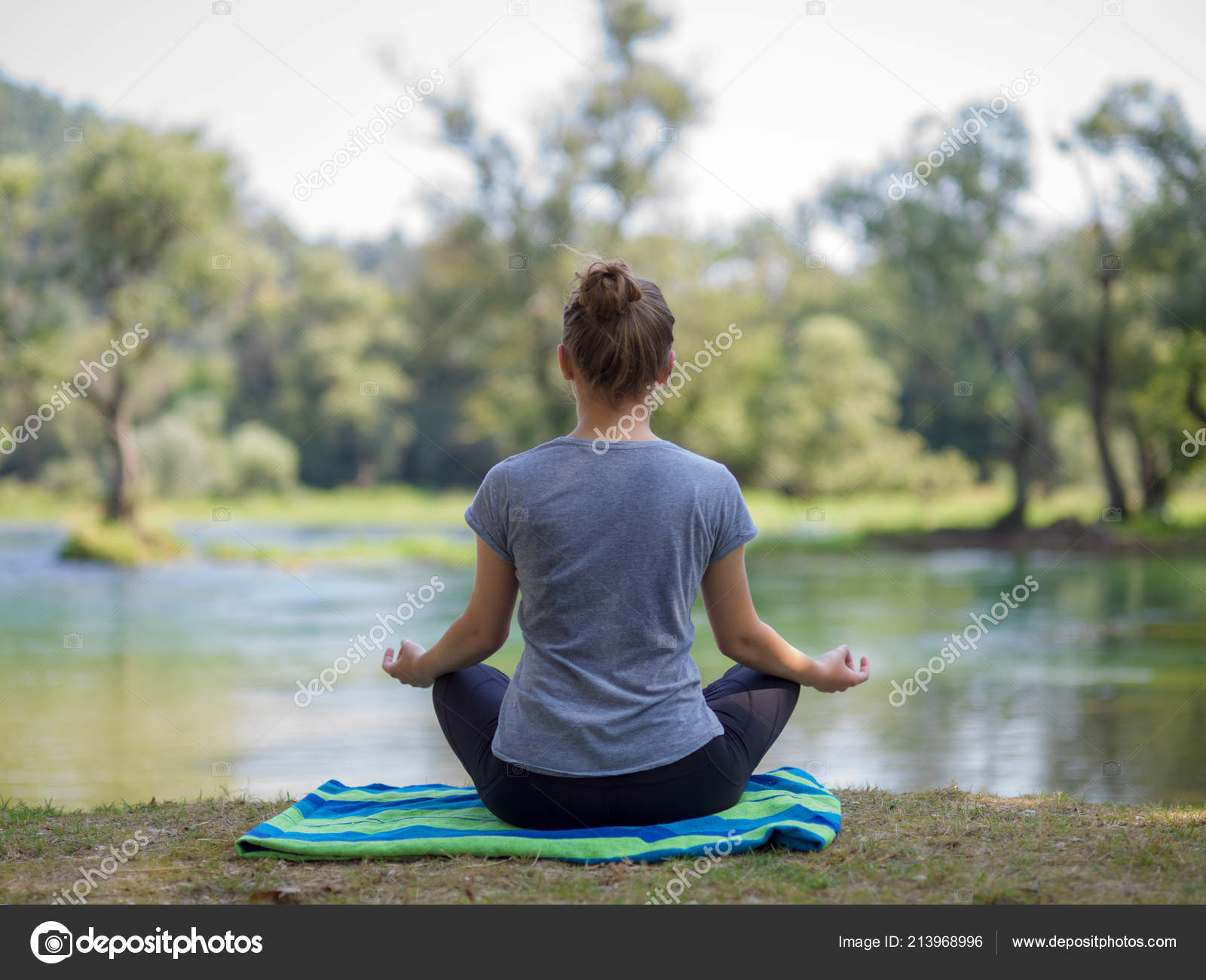 Healthy Woman Relaxing While Meditating Doing Yoga Exercise Beautiful Nature Stock Photo C Shock 213968996