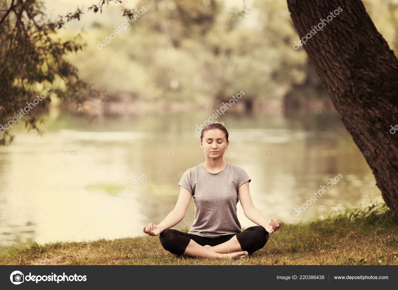 Healthy Woman Relaxing While Meditating Doing Yoga Exercise Beautiful Nature Stock Photo C Shock 220386438