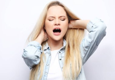 Young attractive woman screaming in horror