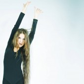 Photo young dancer with long hair over white