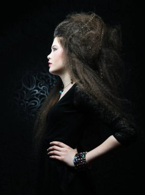 portrait of beautiful woman in black dress with fashion hairstyle. Fashion and beauty concept.
