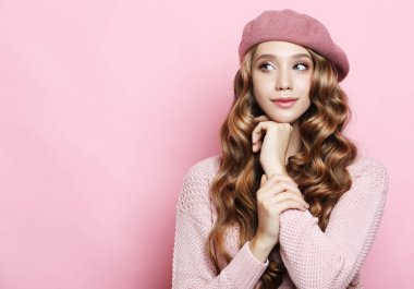 lifestyle, beauty and people concept: Beauty girl with curly perfect hairstyle wearing pink beret over white background