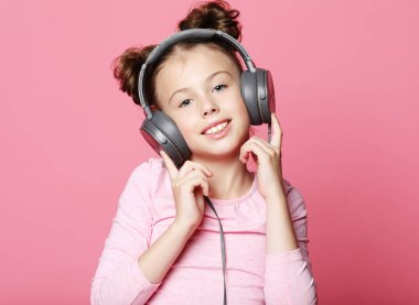 Emotion, childhood, tehnology  and people concept: happy girl  with headphones listening to music stock vector