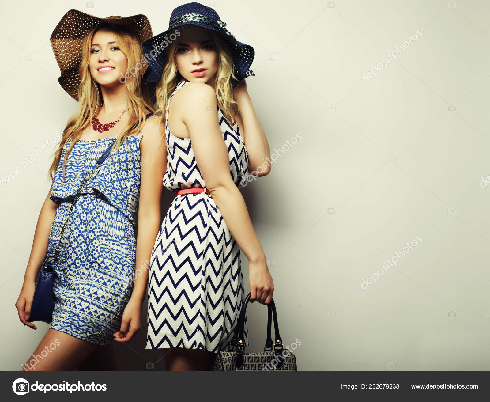 67d220a40d77 Fashion concept  two sexy young women in summer fashion dress and straw hats