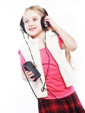 dancing little girl headphones music singing on white background
