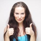 Fotografie Šťastná žena ukazuje palec nahoru