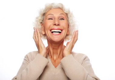 lifestyle, emotion  and people concept: Grey haired old nice beautiful laughing woman. Isolated over vwhite  background