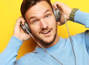 lifestyle and people concept: young man listening to music with