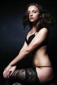 schöne verführerische junge Frau in sexy Dessous