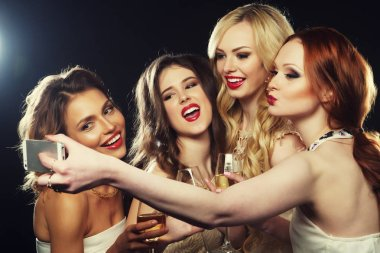 Lifestyle and people concept - Close-up shot of group of laughing girls having party, take selfie with smartphone stock vector