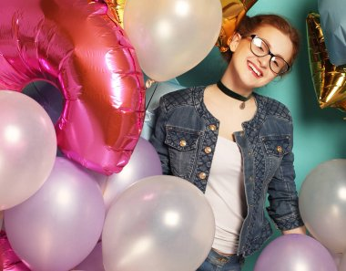 Portrait of happy redhair girl waiting for party. Gorgeous cheerful young woman  having fun with sparkle balloons, over blue background. Lifestyle concept. stock vector