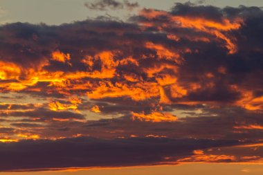 Dramatic clouds in a sunset light