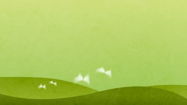 Four white butterflies on the green hills background