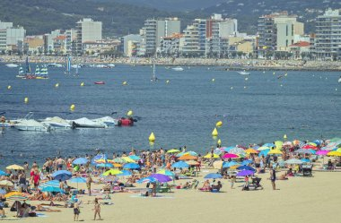 Beach at the small town Palamos (Costa Brava) in Spain in a sunny summer day,(time lapse) 29.07.2018, Spain