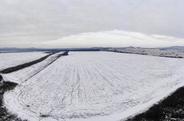 Aerial winter landscape from a snowy field in Hungary